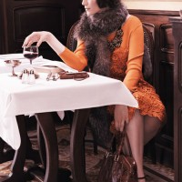 Orange macreme and knit dress from Marina Rinaldi collection.