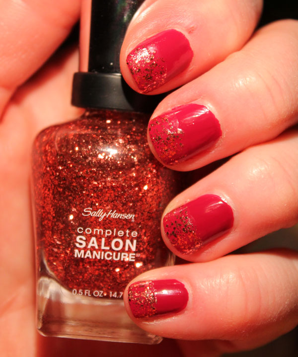 Glitter tips on red nail polish.